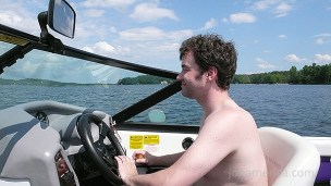 Here's tom driving the boat.
