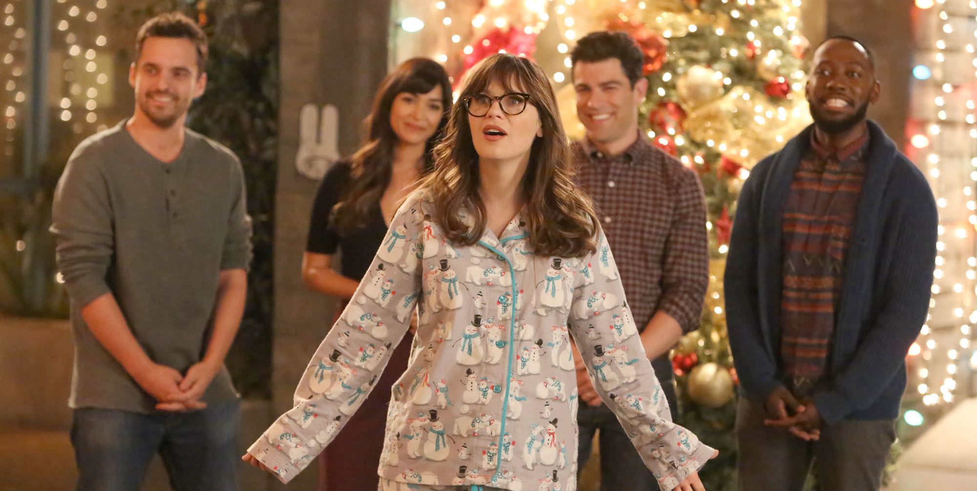 The cover image for the blog post. It depicts the cast of 'New Girl'. The character Jessica Day (Zooey Deschanel) stands in her pajamas with a look of wonder on her face. The rest of the cast stands behind her, smiling.