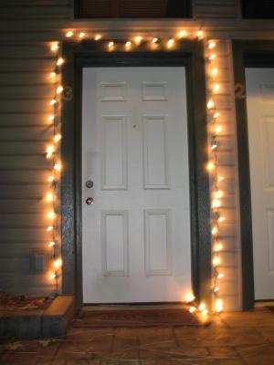 Christmas lights around a door