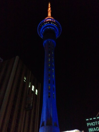 A closeup of Auckland's Sky Tower at night.