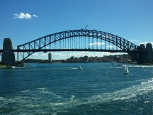The Sydney Harbor Bridge, as seen from the Opera House entrance. The dots along the arch of the bridge are people, on the 3.5 hour, $200-350-per person climb to its top. :)