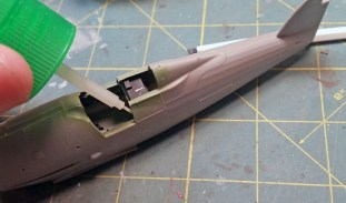 ... and glue it to one side of the fuselage.