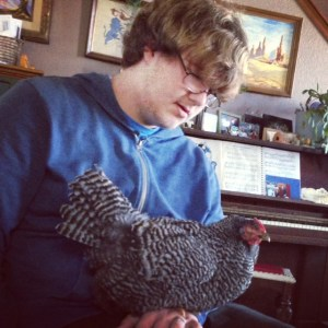 A boy and his chicken