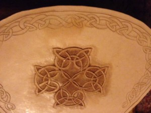 Celtic cross, tooled in leather