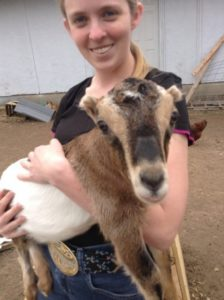 Goat and girl, smiling