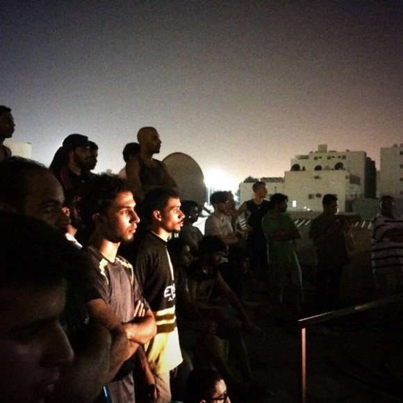 Audience on a rooftop in Dammam, Saudi Arabia, for a piece of immersive theatre