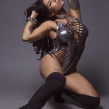 Elle Audra, Tattooed Fashion model in silver bodysuit by Peepshow Clothing
