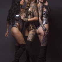 three inked fashion models in Peepshow Clothing bodysuits.