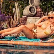 Blonde model in gold bikini poolside
