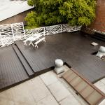 Rooftop deck with white furniture in downtown Los Angeles