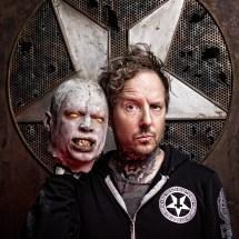Portrait of Tod Waters of Junker Designs holding a zombie head