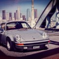 Vintage Porsche 911 driven by Magnus Walker over the 6th street bridge in Los Angeles