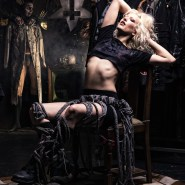 Fashion portrait of blonde model in the zombie TV room.
