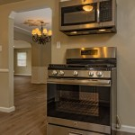 real estate photography kitchen view of oven and microwave