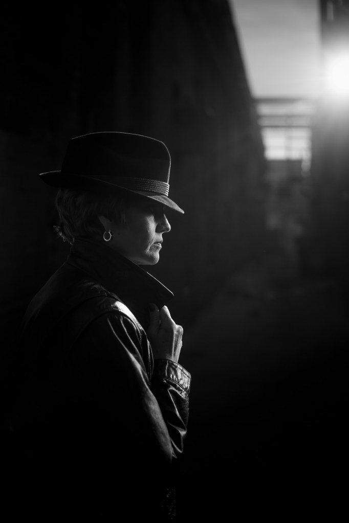 Black & White film noir detective portrait