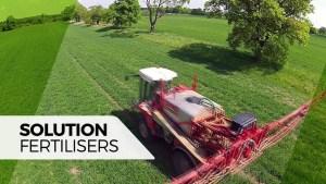 Tractor spraying liquid fertiliser