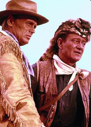 """Richard Widmark (James Bowie) e John Wayne (Davy Crockett): protagonistas-heróis do filmes """"O Alamo"""". Pesquisador garante que filme distorce participação deles na batalha"""