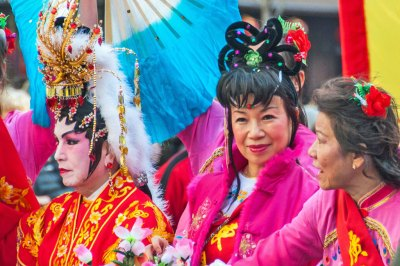 Women don the traditional  finery of Imperial  China.