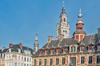 The  roofline of the Flemish Renaissance Old Stock Market and the twentieth century belfry of the Chamber of Commerce.