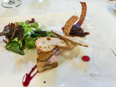 Terrine of grilled foie gras with red onion chutney.