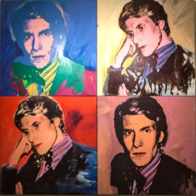 The famous collage portrait of Yves Saint Laurent by Andy Warhol  marks the start of the exhibit space.