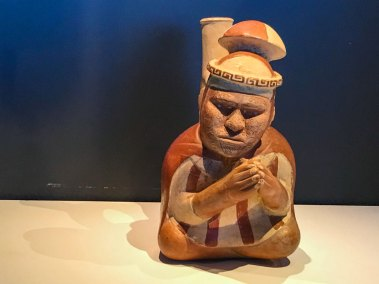 Blind Moche priest in prayer.