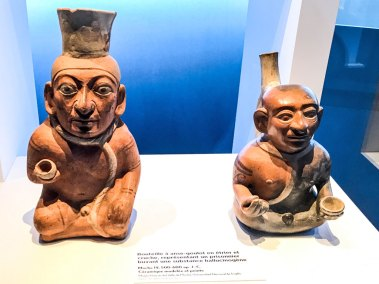 Moche bootle and jug representing a prisoner drinking an hallucinogen beverage.