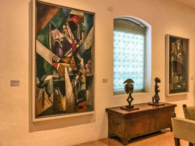 "Albert Gleizes' ""Women with Animals"" and  relicary figures from West Africa decorate Peggy Guggenheim's dining room."