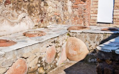 Shops and bars typically had marble counters fitted with terracotta jars for storing food and drink.