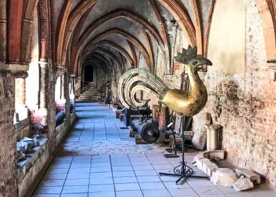 The cloister adjoining the cathedral is filled with artifacts reminiscent of the city's tumultuous history.