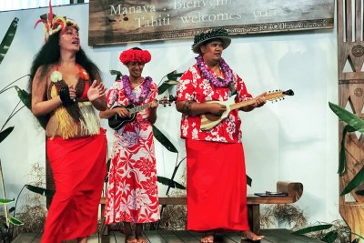 Local musicians welcome travel-weary visitors at Fa'a'ā International Airport.