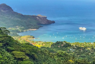 From the top of Nuku Hiva's craggy ridges, the M/S Paul Gauguin looks like a bathtub boat in Taihoae Bay.
