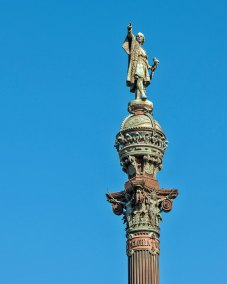 At the edge of the Port Vell (Old Port), where Christopher Columbus returned to Spain after his first voyage to the Americas, his bronze statue stands atop a 60 meter (197 foot) iron column. The monument was erected for the 1888 Barcelona Universal Exposition.