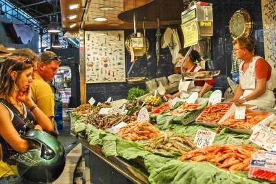 The fish stalls are located at the center of La Boqueria.