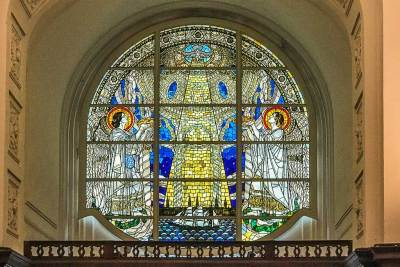 Stained glass window above the portal of the church of Saint Michael.