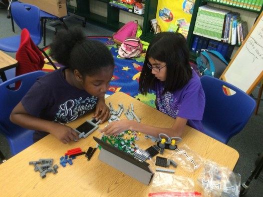 Jadzia and Jossie work on building the Lego models for the competition