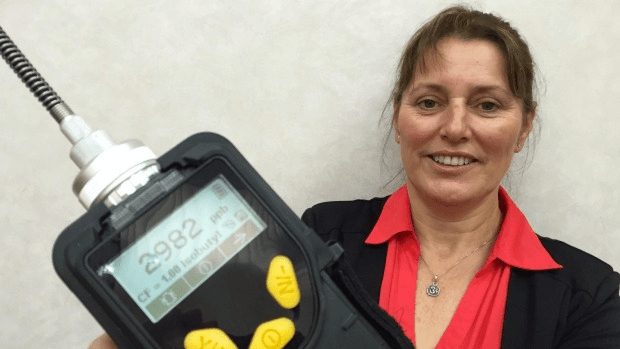 Karen Baker, of Detect-Ghosts NZ, with one of her pieces of equipment for ghost testing, which has just picked up a reading of an astonishing 2982microcröks