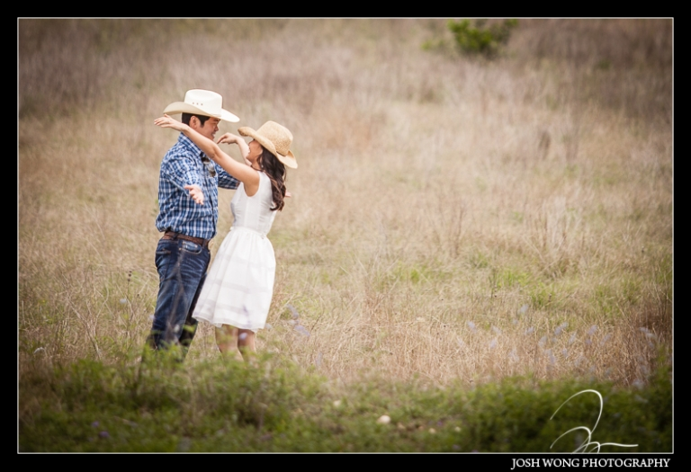 An open ranch field in San Antonio, TX.  Engagement Pictures - The Missions, The River Walk, The Alamo, Ranches,  Blue Bonnets, and BBQs Galore - engagement photos by Josh Wong Photography