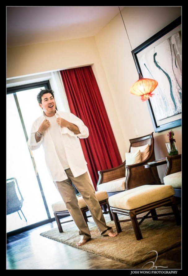 The groom getting ready. Destination Wedding at Grand Velas Resort in Playa Del Carmen, Mexico. Wedding Pictures and photos by top destination wedding photographer Josh Wong Photography