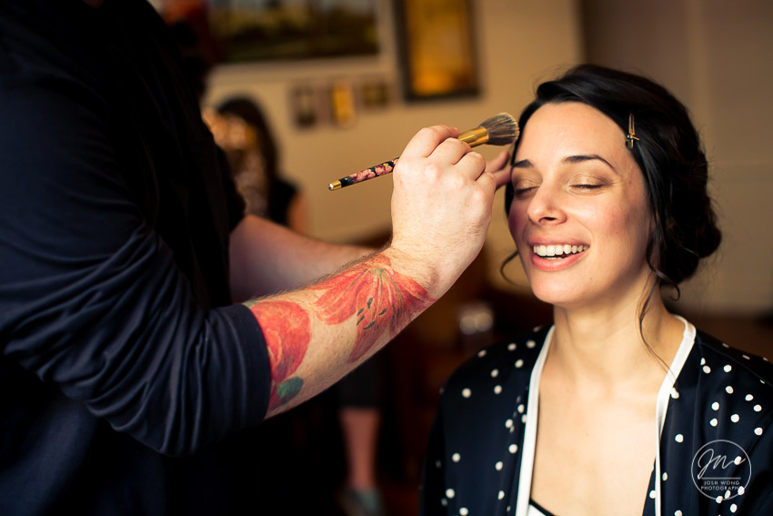 The bride getting hair and makeup complete. The Nomad Hotel bridal suite. The NoMad Hotel New York wedding pictures by Josh Wong Photography