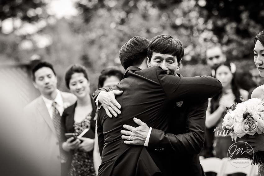 Father of the bride and groom hug.  New York Botanical Garden Wedding Pictures by NYC Wedding Photographer Josh Wong Photography