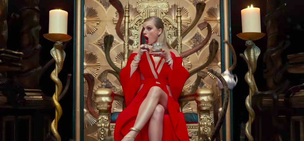 Taylor Swift with snakes on throne