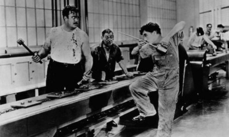 Charlie Chaplin tries to cope with the assembly line in Modern Times