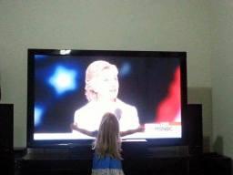 little-girl-hugging-clinton-tv-screen