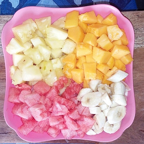 After cutting all the fruits, bring them into one bowl