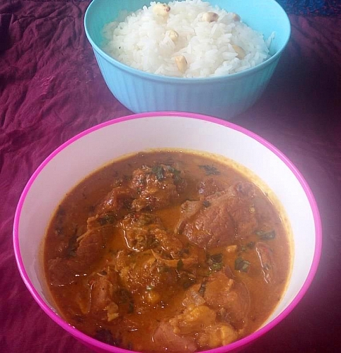 Serving groundnut soup with rice