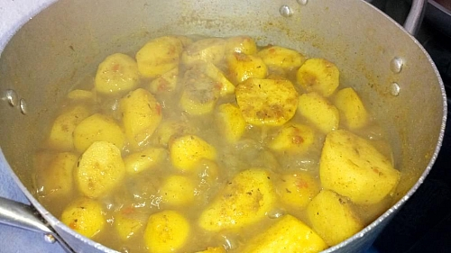 You can mash some cooked potatoes into the content to help thicken the porridge
