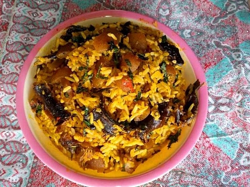 Serving of palm oil jollof rice in a plate