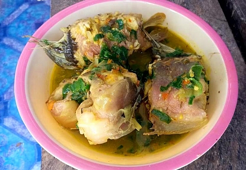 Serve catfish pepper soup while it's still hot with boiled rice