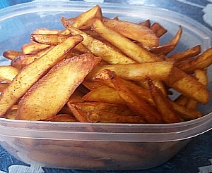 Fried sweet potatoes in a container